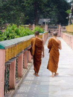 Turning prayer wheels at Mahabodhi Temple