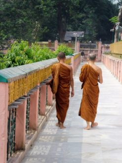 Turning prayer wheels at Mahabodhi Temple