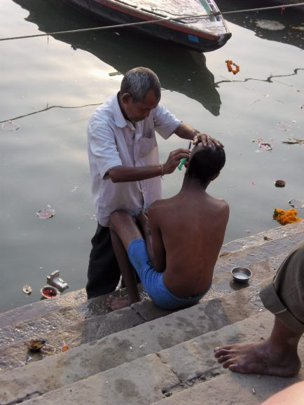 Head shaving on the ghats, Varanasi